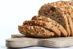 вырезывание отрезока хлеба доски деревянное Стоковые Фотографии RF