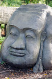 Высекаенная каменная голова Стоковые Фотографии RF