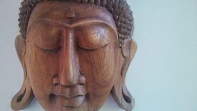 Высекаенный Будда смотрит на 2 Стоковое Изображение RF