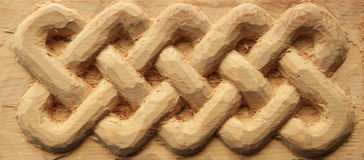 высеканный celtic переплетает древесину Стоковое фото RF