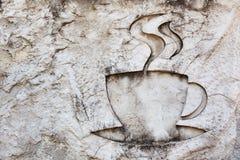 высекать камень знака питья чашки горячий Стоковое Фото
