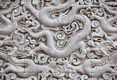 Высекать дракона - близкое поднимающее вверх Стоковые Фото