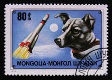 Выследите собаку Laika породы 1-ую в космосе и выпустите ракету, около 1978 Стоковая Фотография RF