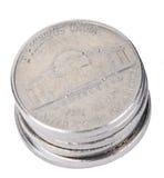Изолированный стог монеток никеля стоковое изображение