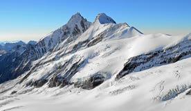 Высокие снежные горы Стоковая Фотография RF