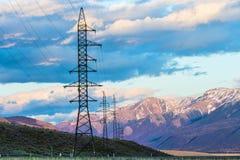 Высоковольтные башни передачи Стоковые Изображения