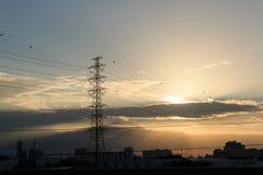 Высоковольтная опора с заходом солнца Стоковое Изображение RF