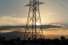 Высоковольтная опора с заходом солнца Стоковая Фотография RF