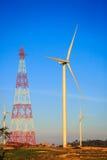 Высоковольтные башня и ветротурбины Стоковое фото RF