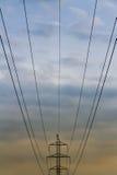 Высоковольтные провода на долгом пути Стоковые Фото