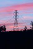 Высоковольтный поляк с сумерк Стоковая Фотография