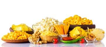 Высококалорийная вредная пища на белой предпосылке Стоковая Фотография RF