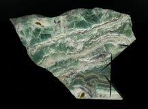 Высокомарочный мрамор Изолировано на черной предпосылке естественным картина камня отполированная отрезком мраморная Стоковое Фото