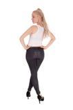Высокорослая тонкая женщина стоя от задней части Стоковое фото RF