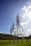 Высокорослые электрические башни передачи Стоковые Фото