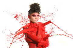 Высокоскоростная фотография женщины с жидкостной краской Стоковые Изображения RF
