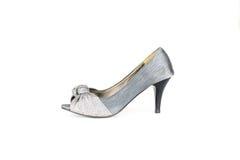 Высоко-накрененный ботинок женщин изолированный на белизне стоковое фото rf
