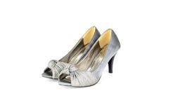 Высоко-накрененный ботинок женщин изолированный на белизне стоковая фотография rf