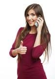 Выставка женского молодого модельного большого пальца руки поднимающая вверх Стоковое фото RF