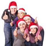 выставка santa людей шлема группы thumbs вверх по детенышам Стоковые Изображения RF