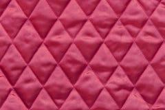 Выстеганная красная ткань сатинировки Стоковая Фотография