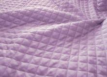 выстеганный пурпур ткани стоковое изображение rf