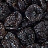 Высушенная картина текстуры предпосылки плодоовощ слив или черносливов Стоковое Изображение RF