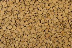 Высушенная предпосылка текстуры корма для домашних животных Стоковое Изображение