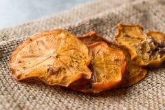 Высушенные куски плодоовощ Kaki хурмы/дата Трабзона сухая Стоковая Фотография RF