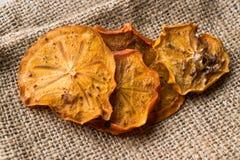 Высушенные куски плодоовощ Kaki хурмы/дата Трабзона сухая Стоковое Изображение RF