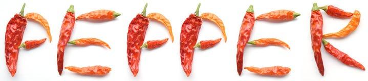 Высушенный алфавит перцев chili Кайенны Стоковое Изображение
