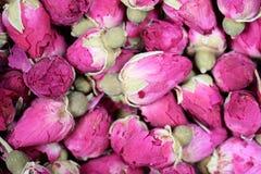 Высушенный крупный план текстуры предпосылки rosebuds Стоковая Фотография