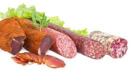 Высушенный tenderloin свинины и 3 различных разнообразия сосисок Стоковое фото RF