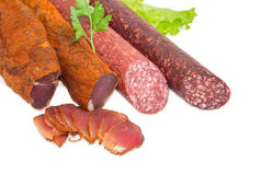 Высушенный tenderloin свинины и 2 различных разнообразия cl сосисок Стоковые Изображения