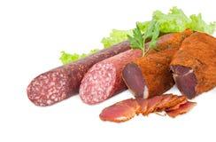 Высушенный tenderloin свинины и 2 различных разнообразия cl сосисок Стоковое Изображение RF