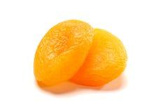 2 высушенных абрикоса на белизне Стоковая Фотография