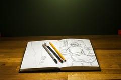 Выучите нарисовать sketchbook с карандашем и чертежами Стоковые Изображения RF