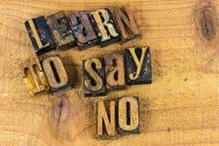 Выучите не сказать никакой letterpress сообщения Стоковое фото RF