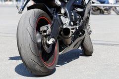 Выхлопная труба, задний тормоз и колесо motorcicle Стоковая Фотография RF
