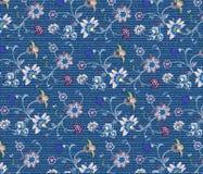 Вышивка цветка на ткани джинсовой ткани Стоковое Изображение