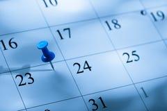 Вышитый штырь на календаре на 23 с стоковые фото
