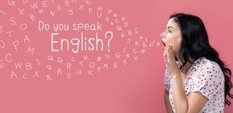 Вы говорите английскую тему с говорить молодой женщины стоковые изображения