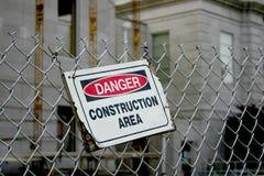 Выдержанный знак района конструкции опасности Стоковое Изображение RF
