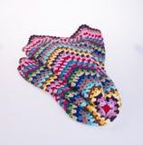 вязание крючком или одеяло вязания крючком на предпосылке Стоковое Фото