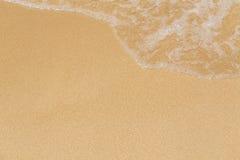 Влажный песок и волна моря Стоковое фото RF