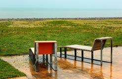 2 влажных стуль на пустом пляже на дождливом дне в Батуми, Georgia Стоковые Изображения
