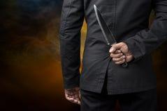 Владение бизнесмена на ноже стоковое изображение