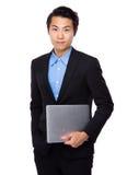Владение бизнесмена с портативным компьютером Стоковые Фото