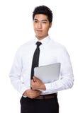 Владение бизнесмена с портативным компьютером Стоковое Фото