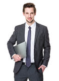 Владение бизнесмена с портативным компьютером Стоковое Изображение